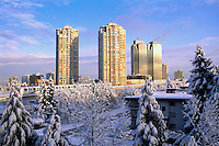 Burnaby, BC, British Columbia, Canada - Skytrain and High Rise Apartment / Condominium Buildings and Office Towers at Metrotown, Heavy Snowfall after Winter Snow Storm