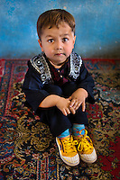School boy in yellow sneakers, Kabul, Afghanistan 2007.