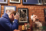 January 23, 2013. Durham, North Carolina. Nick Swartzwelder (left) a Durham native, Duke student and lifelong fan watches in disgust as Duke lost a 63-90 blowout to Miami. He and his frat brothers had gathered at Charlie's Pub and Grille to watch the game.. Duke University has become a power house in the national college basketball arena under the coaching of head coach Mike Krzyzewski. But the university has fought hard to maintain its image of high academic achievement while riding the wave of collegiate athletic success.