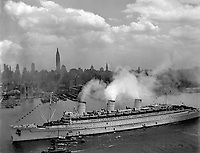 The famous British liner, QUEEN MARY, arrives in New York Harbor, June 20, 1945, with thousands of U.S. troops from European battles.  (Navy)<br /> NARA FILE #:  080-GK-5645<br /> WAR &amp; CONFLICT BOOK #:  1367