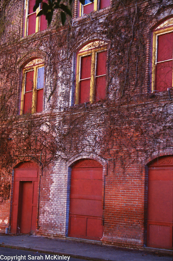 The vine-covered side of the boarded-up and abandoned Palace Hotel in Ukiah in Mendocino County in Northern California.