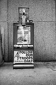 Chicago, Illinois.USA.2003..US newspaper boxes advertise the war in Iraq.