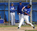 Burlington, CT- 15 May 2017-051517CM08-  Lewis Mills'  Andrew Madden makes contact wit the ball during their Berkshire League matchup against Nonnewaug on Monday.    Christopher Massa Republican-American