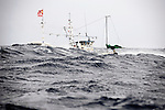 """A fishing boat battles 4-meter-high waves in the waters of the Tsugaru Strait off Oma, northern Japan on 23 September 2008. Oma is well known in Japan as being the landing place for the country's finest quality """"hon maguro"""" or Pacific bluefin tuna, which is also known as """"black diamonds"""" in Japan..Photographer: Robert Gilhooly"""
