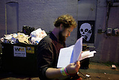 Idependent Weekly Music Editor Grayson Currin ignores warning of cell phone slavery during the 2008 SXSW music festival in Austin, TX.