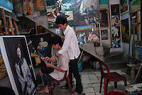 Artists paint replications of famous paintings to sell to tourists in Ho Chi Minh City, Vietnam...Kevin German / LUCEO