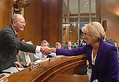 Betsy DeVos of Grand Rapids, Michigan, right, shakes hands with US Senator Lamar Alexander (Republican of Tennessee), Chairman of the US Senate Committee on Health, Education, Labor and Pensions, left, prior to the confirmation hearing considering her nomination to be US Secretary of Education on Capitol Hill in Washington, DC on Tuesday, January 17, 2017.<br /> Credit: Ron Sachs / CNP