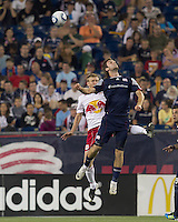 New York Red Bulls defender Tim Ream (5) and New England Revolution midfielder Stephen McCarthy (26) battle for head ball. In a Major League Soccer (MLS) match, the New England Revolution tied New York Red Bulls, 2-2, at Gillette Stadium on August 20, 2011.