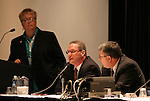 """17 January 2004: USSF secretary general Dan Flynn (center) with Soccer America publisher Lynn Berling-Manuel (left) and Boston Breakers general manager Joe Cummings (right) during a panel discussion titled """"Can Women's Professional Soccer Survive in America"""" at the Charlotte Convention Center in Charlotte, NC as part of the annual National Soccer Coaches Association of America convention.."""