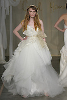 Model walks runway in an Angel Oak wedding dress by Carol Hannah Whitfield, for the Carol Hannah Spring Summer 2012 Bridal collection runway show.