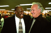 """Former Packers Willie Davis and Paul Hornung celebrate in the Packers' locker room on January 12, 1997 after Green Bay defeated the Panthers 30-13 to win the NFC Championship and advance to their first Super Bowl in 29 years. This was the first title game in Green Bay since the """"Ice Bowl"""" in 1967."""