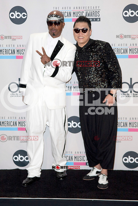LOS ANGELES, CA - NOVEMBER 18: MC Hammer and Psy in the press room at the 40th American Music Awards held at Nokia Theatre L.A. Live on November 18, 2012 in Los Angeles, California. Credit: mpi20/MediaPunch Inc. /NORTEPHOTO