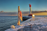 A wintery sunset view of the lighthouse pier in Oakville, Ontario