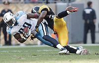 PITTSBURGH, PA - OCTOBER 09:  Jared Cook #89 of the Tennessee Titans is tackled by Ryan Mundy #29 of the Pittsburgh Steelers after catching a pass during the game on October 9, 2011 at Heinz Field in Pittsburgh, Pennsylvania.  (Photo by Jared Wickerham/Getty Images)