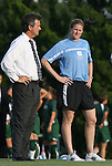 22 August 2008: UNC head coach Anson Dorrance (left) and volunteer assistant coach Cindy Parlow (right). The University of North Carolina Tar Heels defeated the UNC Charlotte 49'ers 5-1 at Fetzer Field in Chapel Hill, North Carolina in an NCAA Division I Women's college soccer game.
