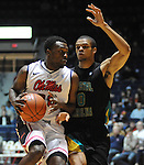 "Mississippi's Nick WIlliams (20) dribbles against  Coastal Carolina's Warren Gillis (0) at the C.M. ""Tad"" Smith Coliseum in Oxford, Miss. on Tuesday, November 13, 2012. (AP Photo/Oxford Eagle, Bruce Newman)"
