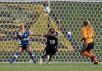 BOYDS, MARYLAND-JULY 07,2012:  Ashley Herndon (15) of DC United Women hits the ball high over Ashley Daniels (12) of Dayton Dutch Lions during a W League game at Maryland Soccerplex, in Boyds, Maryland. DC United women won 4-1.