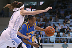 16 November 2014: UCLA's Jordin Canada (right) and North Carolina's Megan Buckland (left). The University of North Carolina Tar Heels hosted the University of California Los Angeles Bruins at Carmichael Arena in Chapel Hill, North Carolina in a 2014-15 NCAA Division I Women's Basketball game. UNC won the game 84-68.