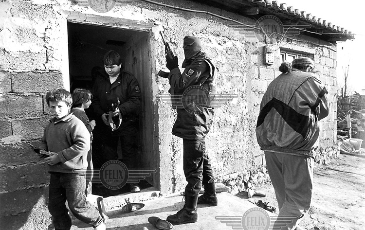 ©Francesco Cito/Panos Pictures..Shkoder, Albania. Police searching for man in Barbulwsh village.