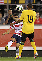COLUMBUS, OHIO - SEPTEMBER 11, 2012:  Herculez Gomez (9) of the USA MNT sends a cross past Adrian Mariappa (19) of  Jamaica during a CONCACAF 2014 World Cup qualifying  match at Crew Stadium, in Columbus, Ohio on September 11. USA won 1-0.