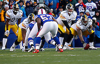 ORCHARD PARK, NY - NOVEMBER 28:  Ben Roethlisberger #7 of the Pittsburgh Steelers stands behind teammate Maurkice Pouncey #53 during the game against the Buffalo Bills on November 28, 2010 at Ralph Wilson Stadium in Orchard Park, New York.  (Photo by Jared Wickerham/Getty Images)