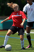 Aztec MA midfielder Tori McCombs (8) passes the ball. In a Women's Premier Soccer League (WPSL) match, Aztec MA defeated CFC Passion, 4-0, at North Reading High School Stadium on July 1, 2012.