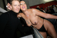 Switzerland. Geneva. Extasia 05 is the first erotic and sex fair. Rocco Siffredi, one of the biggest porn star known for the size of his penis, and a fan, a woman wearing a sexy underwear and with both breasts naked.  © 2005 Didier Ruef