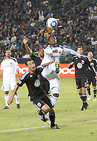 LA Galaxy forward Edson Buddle (14) battles DC United defender Jed Zayner (12) for the ball during the first half of the game between LA Galaxy and the D.C. United at the Home Depot Center in Carson, CA, on September 18, 2010. LA Galaxy 2, D.C. United 1.