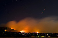 Santa Barbara, California - HIgh winds fuel out of control Jesusita fire as it burns in the  mountains and foothills above Santa Barbara on its second night, Wednesday, May 6, 2009