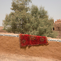 Morocco - Ouarzazate - A carpet dries in the sun in the Kasbah Taourirt. Before studios were built, several movies used the Kasbah for their setting, including Rules of Engagement, a 2000 movie starring Samuel L. Jackson and Tommy Lee Jones and set in Yemen. In order to stage an attack against the American embassy in Yemen, the production hired the whole Kasbah and hundreds of its inhabitants as background actors.