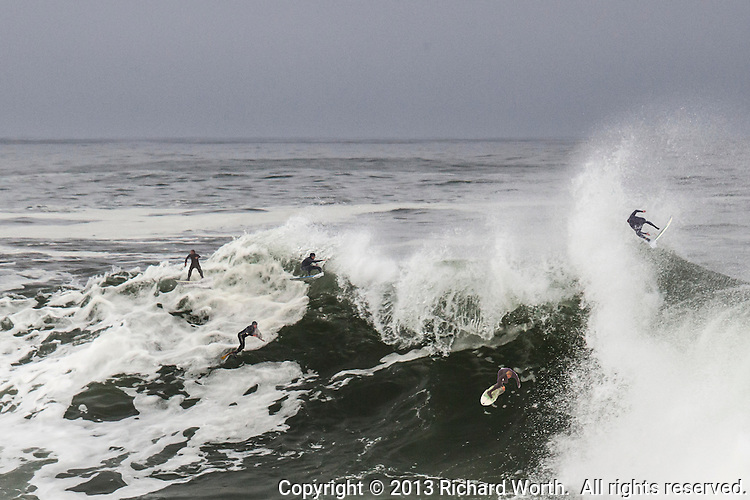 An image of a wave crashing into Bean Hollow State Beach enhanced to include the surfer dudes who weren't there.  Just a bit of Friday Fun.
