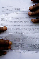 """20 year old Tamba from Liberia holds a letter sent to him by his uncle warning him not to return to Liberia or he will be killed. His parents were killed during the civil war in Liberia and after walking to a refugee camp in Sierra Leone, and sleeping at the airport a man helped him escape. """"February 2005 was the last time I slept in a bed. I sleep on the night bus if I have a bus pass, or in the park, in a phone box or behind a car wash. English people think about how they can make progress. Me, I think about where I'm going to sleep tonight. Sometimes I am allowed to sleep on the floor of a barber's shop in exchange for cleaning the shop for the owner. I get pains in my body from the bad way I have to sleep. Sleeping outside used to make me panic but I've got used to it now."""" Tamba is one of an estimated 300,000 rejected asylum seekers living in the UK. .. ."""