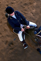 Horse and rider leaving the arena after succesful jumping.<br /> Show jumping at Malmo Civila Ryttareforening in Malmo, Sweden.<br /> November 2006.<br /> Only for editorial use.