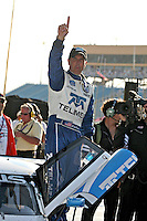 Scott Pruett celebrates after winning the Gainsco Grand Prix of Miami Grand Am Rolex Seires sports car race at Homestead-Miami Speedway in Homestead, FL in March of 2008. (Photo by Brian Cleary/www.bcpix.com)
