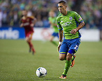 Clint Dempsey of the Seattle Sounders FC dribbles the ball during play against Real Salt Lake at CenturyLink Field in Seattle Friday September 13, 2013. The Sounders won the match 2-0.