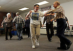 SOUTHBURY, CT06 January 2006-010606TK06 (left to right:) Seniors square dancers at the  Southbury Senior Center located in the Southbury Town Hall enjoyed some indoor exercise through square dance sets Friday morning. Brenda Sherwood of Southbury passes by Joe Cortellino of Naugatuck during a square dance session held on Friday morning from 10:15 thru 11:45.  Interested seniors are welcomed.  Tom Kabelka / Republican-American (square dancers, Joe Cortellino, Brenda Sherwood)CQ