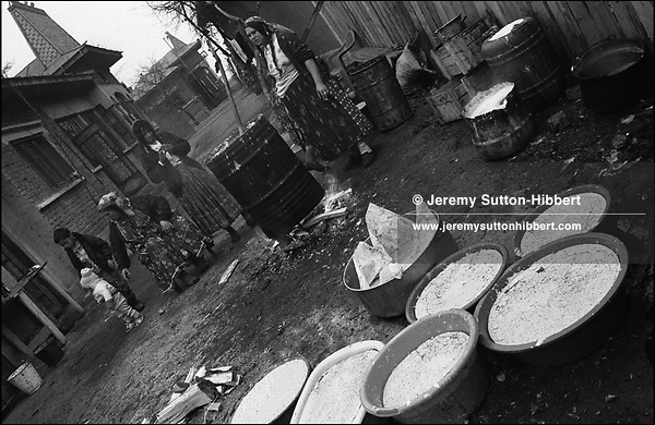 WAITING AS THEY MAKE SOAP. SINTESTI, ROMANIA. NOVEMBER 1996..&copy;JEREMY SUTTON-HIBBERT 2000..TEL./FAX. +44-141-649-2912..TEL. +44-7831-138817.