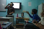 A tutor gives lessons for the deaf students in a  classroom at the Noida Deaf Society in Noida, Uttar Pradesh, India.