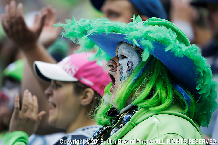 Seattle Seahawks fans cheers against the Tennessee Titians at CenturyLink Field in Seattle, Washington on October 13, 2013. The Seattle Seahawks beat the Titians  20-13.   ©2013. Jim Bryant Photo. All Rights Reserved.