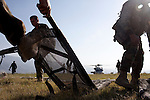 U.S. Navy security forces set up stretchers in a helicopter landing zone in Port-au-Prince, Haiti, used to transport victims of the recent earthquake to the USNS Comfort, a naval hospital ship.