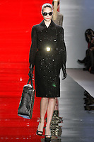 Brenda walks runway in a ebony metallic boucle double breasted trench coat, from the Reem Acra Fall 2012 Feminine Power collection fashion show, during Mercedes-Benz Fashion Week New York Fall 2012 at Lincoln Center.