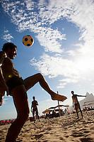 Young men play soccer at Ipanema beach, Rio de Janeiro, Brazil.