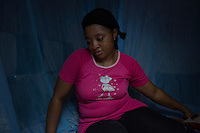 "Cameroon - Douala - ""Since I had met him, he always had the intention to leave. We have been together for 9 years, but I knew that, one day, he would have left."" With her low-tone of voice and her remissive behaviour, 31-year-old Lady Njoya is a woman worn out by life. One year ago, she was raising her three children in the city of Yaounde, together with her husband, 47-year-old Ismael Njoya. Now that he is gone, she has moved to the business city of Douala, where she rents a minuscule house in a popular area."