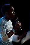 Muyiwah Olofun tells his story at Powershift UK. (©Robert vanWaarden)