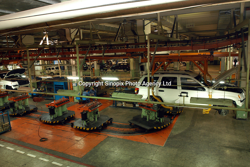 "The production line of ""Grand Cherokee"" of Chrysler in the Beijing Jeep factory.."