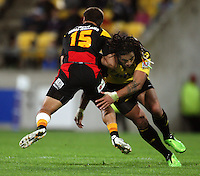 Ma'a Nonu tries to tackle Tim Nanai-Williams during the Super 14 rugby match between the Hurricanes and Chiefs at Westpac Stadium, Wellington, NewZealand on Saturday, 1 May 2010. Photo: Dave Lintott / lintottphoto.co.nz