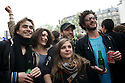 A group of friends celebrates Hollande victory singing and drinking.