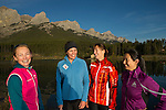 Four women pose for a photo along a trail in the Canadian Rockies on a late summer morning in Canmore Alberta, Canada.  Photo by Gus Curtis.
