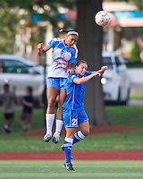 Chicago Red Stars defender/forward Ashlee Elliott (2) and Boston Breakers midfielder Jessica Luscinski (21) compete for a head ball.  The Boston Breakers beat the Chicago Red Stars 1-0 at Dilboy Stadium.