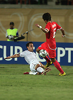 The United States' Danny Cruz (5) dives for the ball against South Korea's Jeong Ho Hong (6) during the FIFA Under 20 World Cup Group C match between the United States and South Korea at the Mubarak Stadium on October 02, 2009 in Suez, Egypt. The US team lost 3-0.